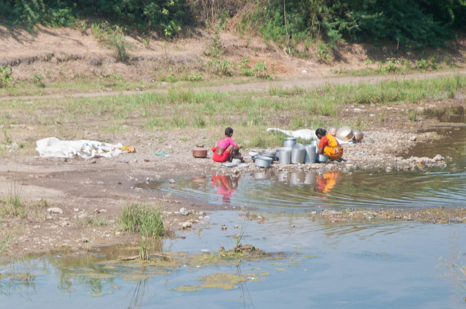 Waschen am Fluß